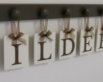 Personalized Housewarming Gift Hanging Ribbon Wooden Letters Last Name Sign with Pegs Painted Chocolate Brown
