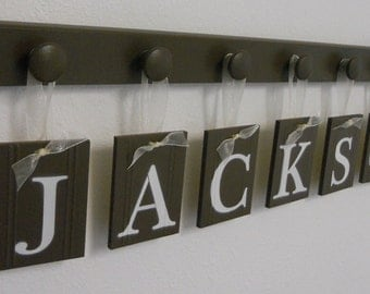 Wall Art Decor for JACKSON includes 7 Wooden Pegs Painted Brown