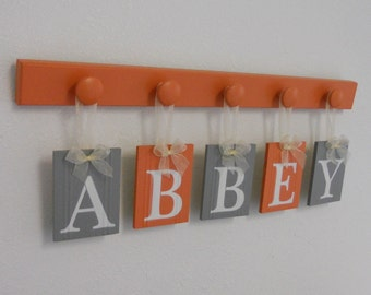 Orange Gray Baby Girl Nursery Wall Letters Sign Set Includes Wooden Pegs Painted in Orange Personalized Hanging Ribbon Letters