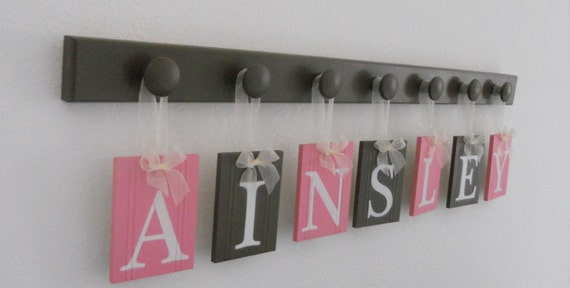 Kids Bedroom Wall Hanging First Name Sign for AINSLEY includes 7 Wood Pegs Chocolate Brown and Pink