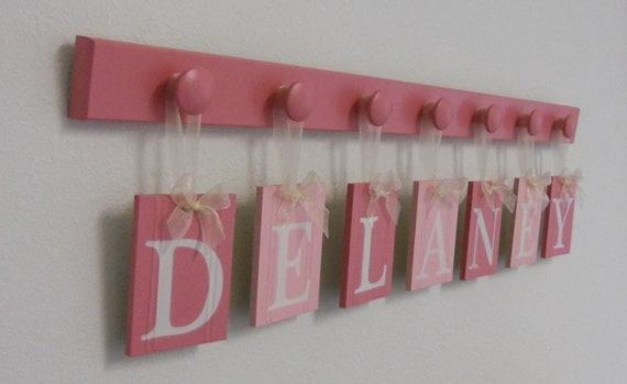 Custom Wall Plaques - Name Wall Hanging - Baby Girl Nursery Room Decor set with 7 Wooden Pegs Pink - Personalized for DELANEY