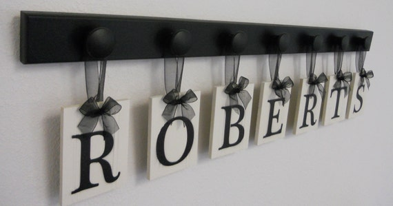Hanging Ribbon Letters for ROBERTS Family Last Name with 7 Black Wooden Hangers Custom Sign for Wedding Gifts.