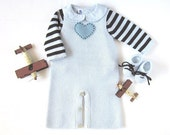 A knitted overalls with sweater and booties