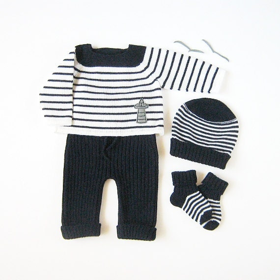 Knitted sweater, ribbed pants, hat and socks set in navy and of white for a baby boy. Newborn. 100% wool.