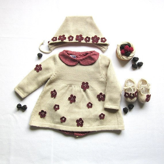 A knitted baby dress full of little flowers. 100% wool. Newborn