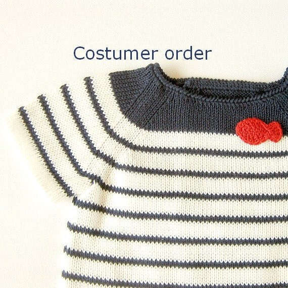 A knit sweater  with a red little fish - costumer order