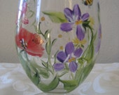 Hand painted wildflower wine glass with daisies , violets and poppies. Reserved two available