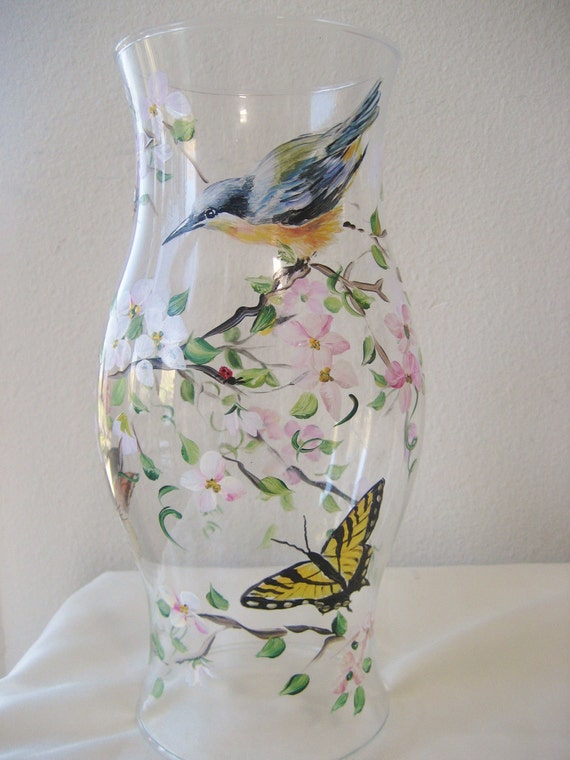 Hanpainted hurricane with nuthatch and swallowtail butterflies