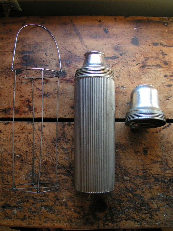 Vintage Silver Ribbed Aluminum Universal Thermos with wire holder, dated 1914