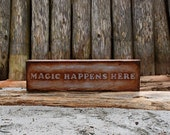 "Sign Post - ""Magic Happens Here"""