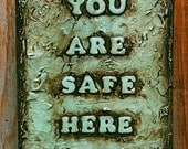 """Sign Post- """"You Are Safe Here""""  10 x 12"""" x 2"""". Pale retro blue green."""