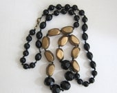 Vintage classic 1940s long black and gold celluloid faceted bead necklace