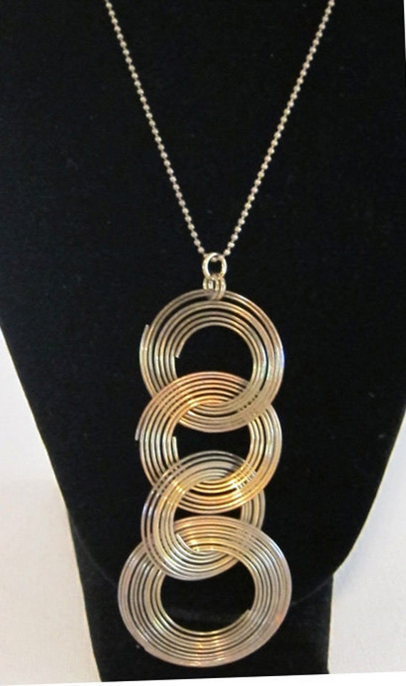 Vintage retro groovy 1970s tribal brass ring pendant