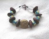AMAN African seeds Krobo glass brass blue and yellow Bracelet by Fianaturals