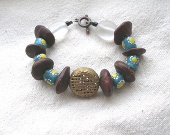 AMAN African seeds Krobo glass brass blue and yellow Bracelet by Fianaturals
