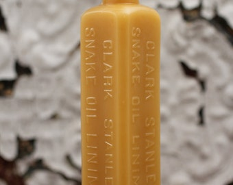 """beeswax Candles - antique bottle shaped - """"SNAKE OIL"""" - by Pollen Arts - Md."""