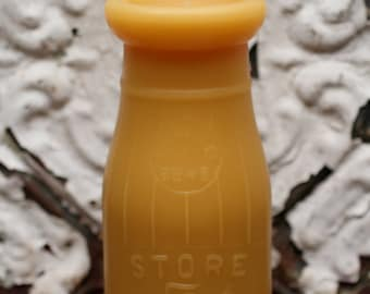 """Beeswax Candle - antique bottle shaped - """"FIVE CENT DAIRY half pint"""" - by Pollen Arts - Md."""