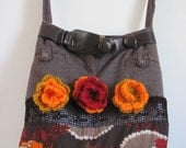 A handmade bag made of fabrics and crocheted flowers one of a kind purse directly from the artist