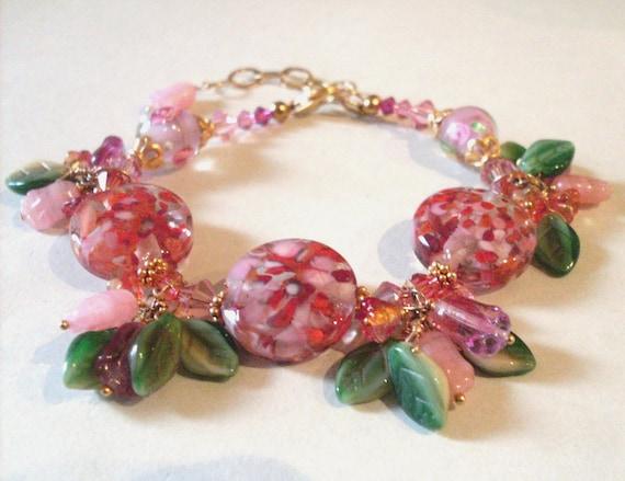 Flower charm bracelet, orange pink green. Wire wrapped beaded bracelet. Art glass, Swarovski, Gold Vermeil. Flower charm jewelry. REDUCED.