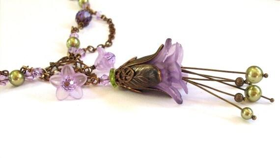Lucite flower necklace, purple, antique brass. Mauve layered flower pendant. Swarovski green pearl stamens, crystals. Purple flower jewelry.