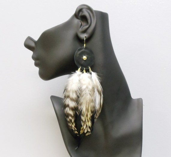 Big gold plated statement feather and leather earrings