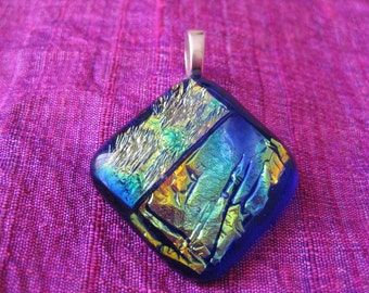 Dichroic fused glass pendant, opalesque and blue.