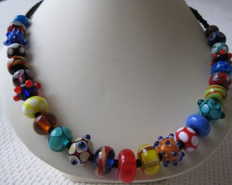 lampwork glass bead necklace, colourful allsorts with onyx beads.
