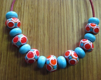 Glass Lampwork Bead Set, Mosaic Dots in Orange, Coral, Turquoise and Ivory with Turquoise Spacers.