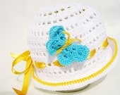 """White crocheted baby hat """"Blue Butterfly"""" from cotton yarn"""
