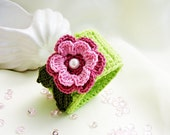 Crocheted bracelet for children in apple green and beautiful flower