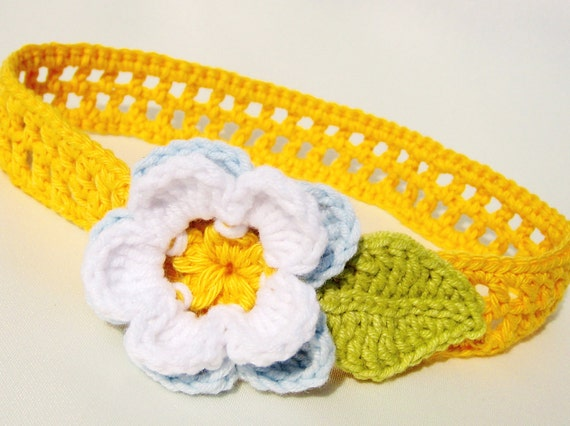 Crochet headband for babies and children in bright yellow, decorated with flower