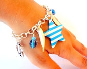 Nautical Star Charm Bracelet - Blue and White Striped Star Charm Bracelet with Silver colored Anchors, Sea Shells and Blue Beads Charms