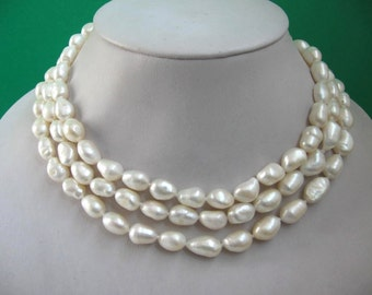 48 Inch Long Genuine Rice Shaped Baroque White Freshwater Pearl Rope Necklace