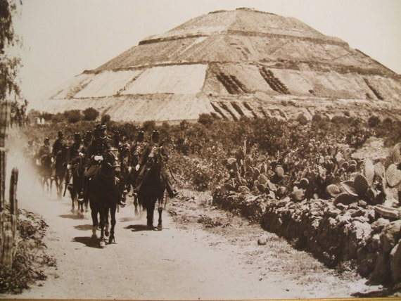 Federales riding past the Pyramid of Teotihuacan