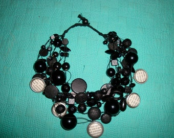 Handmade Bead  statement necklace with charms ( Black, cream, cameos)