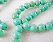 Blue Green Magnesite beads, 4mm - 5mm rounds (Half Strand)