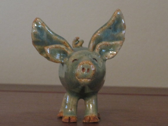 Green Flying Pig made of clay