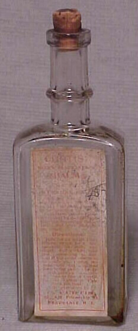c1890s Curtis Sovereian Balm Curtis No. 426 Friendship St. Providence, R.I. , Cork Top Medicine Bottle with the original Label