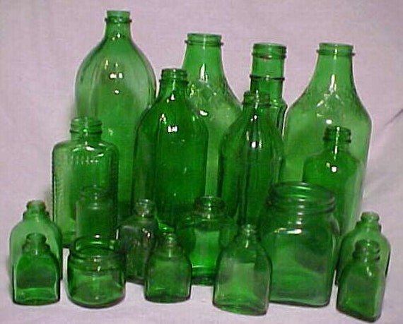 c1940s-50s Group of 19 Emrald Green Glass Medicine and Food Bottles and Jars