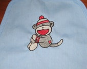 Sock Monkey embroidered on pale blue child apron