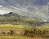 Late winter low cloud rolling over Square Butte in Montana is subject of this small oil painting