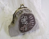 Floral frame purse with hand embroiedered
