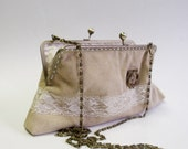 Leather purse evening bag with lace and flower decoration