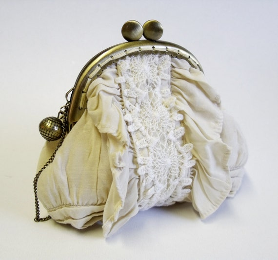Butter yellow laced frame purse