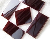 """Flashed glass """"Fair and Square"""" quilt block design in red over clear glass"""