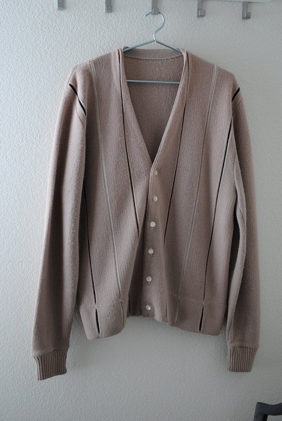 a vintage 70s men's cardigan sweater. khaki with vertical stripes.