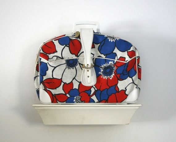 on hold until friday...1960s small suitcase in a bright colorful floral print