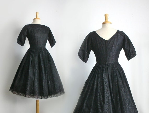 1950s black lace boat neck dress with 3/4 sleeves , size medium