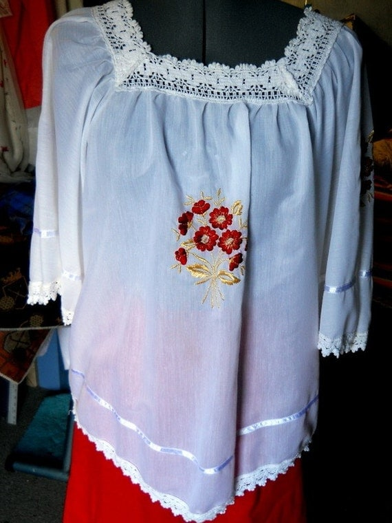 Beautiful Smock Style White blouse with red embroidered flowers.