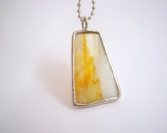 Milky white and yellow stained glass trapezoid pendant